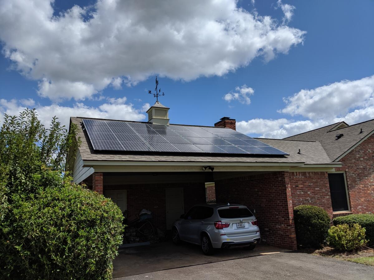 Home with solar panels above garage
