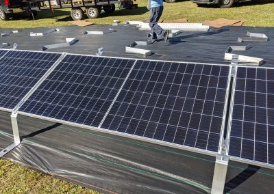 To keep the panels low to the ground, we used a ballasted racking system on this grid tie with battery backup system in Thomasville, Georgia.