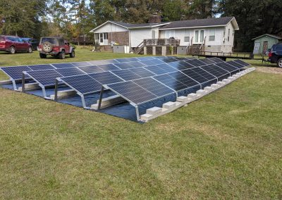 Image 2 - To keep the panels low to the ground, we used a ballasted racking system on this grid tie with battery backup system in Thomasville, Georgia.