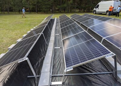 Image 3 - To keep the panels low to the ground, we used a ballasted racking system on this grid tie with battery backup system in Thomasville, Georgia.