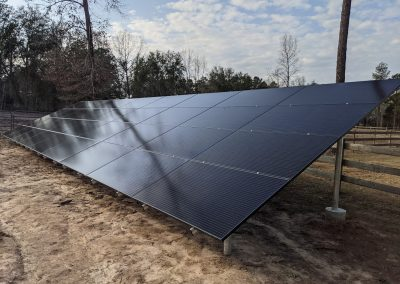 Image 2 - Large grid tie with battery backup ground mount array in Leary, Georgia.